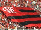 A torcida do Flamengo faz a festa no Mané Garrincha: novo recorde de público.